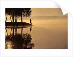 Man Fishing at Lake by Corbis