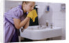 Girl Washing Her Face at Sink by Corbis