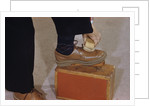 Man Buffing His Shoes by Corbis