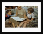 Mother Reading Book to Children by Corbis