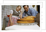 Father and Daughter Looking at Fallen Cake by Corbis