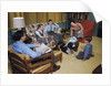Family in Living Room with Dog by Corbis