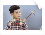 Boy Playing with Tinkertoys (TM) by Corbis
