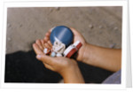 Child Holding Toys by Corbis