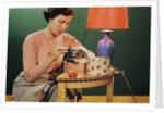 Woman Darning Socks by Corbis