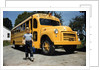 School Bus Dropping off Child at Home by Corbis