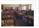 Classroom with Chairs on Desks by Corbis