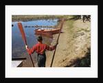 Boy Holding Oars by Corbis