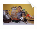 Boy Overwhelmed by Dirty Dishes by Corbis