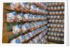 Clown Heads on Rack in Factory by Corbis