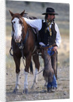 Cowboy Waiting with Horse by Corbis