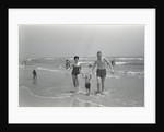 Family Walking on the Beach by Corbis