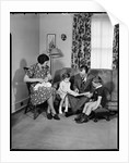 Family in Their Living Room by Corbis