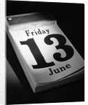 Friday the 13th Page on Desk Calendar by Corbis