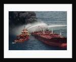 Boat Pours Water On Burning Oil Tanker by Corbis