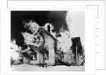 Burning House in Winter by Corbis