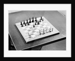 Chess Board with Moved Pieces by Corbis