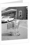 Shopping Cart In Grocery Parking Lot by Corbis