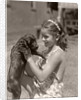 Girl Holding Puppy by Corbis