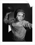 Boy Throwing a Football by Corbis