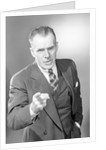 Businessman Pointing by Corbis