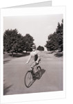 Businessman Riding a Bicycle by Corbis