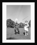 Band Members Twirling Batons by Corbis