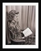 Seated Woman Reading Bible by Corbis