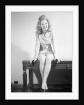 Woman Seated on Desk by Corbis