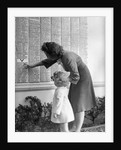 Woman And Daughter At Honor Roll Wall by Corbis