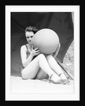 Woman in Bathing Suit Holding Beach Ball by Corbis