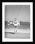 Man Carrying Woman on Beach by Corbis