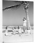 Group Of Women On Beach by Corbis