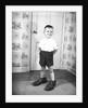 Boy Wearing Men's Shoes by Corbis