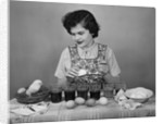 Girl Coloring Easter Eggs by Corbis