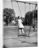 Girl Standing on Swing by Corbis