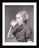Girl Drinking Glass of Milk by Corbis