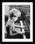 Boy Practicing Piano by Corbis