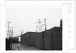 Antennas on Rooftop by Corbis