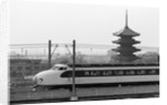 Bullet Train Running Past Pagodas by Corbis