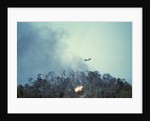 US Plane Dropping Bombs on Hill 875 by Corbis