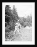 Fisherman Casting in River by Corbis