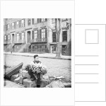 Boy Selling Flowers by Corbis
