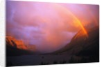 Rainbow and Clouds over a Valley by Corbis