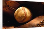 Old Baseball in Glove by Corbis