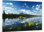 Clouds in Sky Reflected by Mountain Lake by Corbis