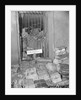 Newspapers Piled High in a Room by Corbis