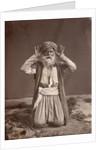 Muslim Man Poses in Prayer by Corbis