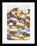 Gold and Silver Sugared Almonds by Corbis