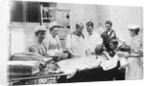 Doctors Administering Anesthesia to a Patient by Corbis